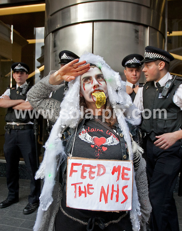 **ALL ROUND PICTURES FROM SOLARPIX.COM**                                             **NO UK NEWSPAPER PUBLICATION**.**UK MAGAZINE & SUPPLEMENT PUBLICATION ONLY** AND NO PUBLICATION IN AUSTRALIA, BELGIUM, FRANCE, GERMANY, ITALY, SCANDINAVIA AND USA**                                                                                  Occupiers from Occupy London held a flash mob dance protest, dressed as zombie bankers. .The demonstration began behind  St Paul's cathedral, before moving through the City of London..Picture shows:  Protesters outside RBS                                                                               JOB REF:  14133      SFE       DATE:   31.10.11                                                         **MUST CREDIT SOLARPIX.COM OR DOUBLE FEE WILL BE CHARGED**                                                                      **MUST AGREE FEE BEFORE ONLINE USAGE**                               **CALL US ON: +34 952 811 768 or LOW RATE FROM UK 0844 617 7637**