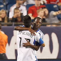Montreal Impact substitute midfielder Sanna Nyassi (11) celebrates his goal with teammate. In a Major League Soccer (MLS) match, Montreal Impact defeated the New England Revolution, 1-0, at Gillette Stadium on August 12, 2012.
