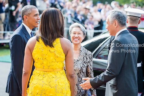 United States President Barack Obama and First Lady Michelle Obama welcome Mrs. Lee Hsien Loong and her husband Prime Minister Lee Hsien Loong of Singapore (l-r) to the White House with a ceremony on the South Lawn on August 2, 2016 in Washington, DC. The Official visit includes a State Dinner this evening.  <br /> Credit: Pete Marovich / Pool via CNP