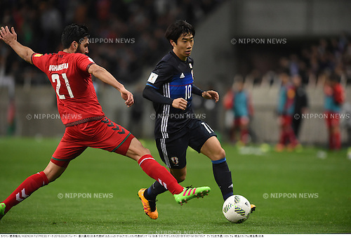 Kanischka Taher (AFG), Shinji Kagawa (JPN),<br /> MARCH 24, 2016 - Football / Soccer :<br /> FIFA World Cup Russia 2018 Asian Qualifier Second Round Group E match between Japan 5-0 Afghanistan at Saitama Stadium 2002 in Saitama, Japan. (Photo by Takamoto Tokuhara/AFLO)