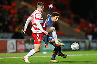 Jordan Gibson of Bradford City and Tommy Rowe of Doncaster Rovers during the Sky Bet League 1 match between Doncaster Rovers and Bradford City at the Keepmoat Stadium, Doncaster, England on 19 March 2018. Photo by Thomas Gadd.