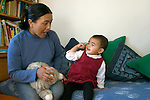 Berkeley CA Nepalese mother naming eye while daughter, nineteen-months-old, identifies her own eye MR