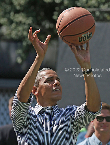 United States President Barack Obama plays basketball during the annual Easter Egg Roll on the White House tennis court April 1, 2013 in Washington, DC. Thousands of people are expected to attend the 134-year-old tradition of rolling colored eggs down the White House lawn that was started by President Rutherford B. Hayes in 1878. .Credit: Mark Wilson / Pool via CNP