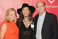 WWW.BLUESTAR-IMAGES.COM (L-R) Caroline Smedvig, singer Steven Tyler and singer James Taylor attend 2014 MusiCares Person Of The Year Honoring Carole King at Los Angeles Convention Center on January 24, 2014 in Los Angeles, California.<br /> Photo: BlueStar Images/OIC jbm1005  +44 (0)208 445 8588