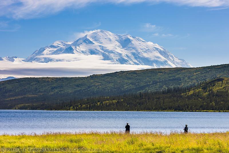 Fly Fishing At Wonder Lake, With The North Face Of Mt. Denali Visible On The Horizon, Denali National Park, Interior, Alaska.