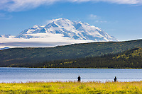 Fly Fishing At Wonder Lake, With The North Face Of Mt. Denali Visible On The Horizon, Denali National Park, Interior, Alaska.