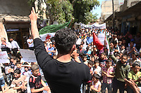 Photographer: Rick Findler..27.04.12 A young man leads the anti Assad chants at a rally against President Assad's regime in Armanaz, Northern Syria after Friday prayers this afternoon. The people in Syria still protest against Assad's evil ways, and a ceasefire is far from over after yet another battle in Idlib City today.