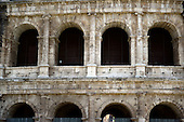 Exterior photo of the Colosseum, also known as the Flavian Amphitheatre, showing the remaining Tuscan, bottom, and Ionic, top, architecture on the outer wall on the north side of the structure, in Rome, Italy on Friday, May 25, 2012.  The gate entrance numbers over the lower arches are still clearly visible..Credit: Ron Sachs / CNP