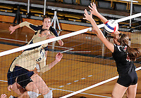 Florida International University women's volleyball player Silvia Carli (9) plays against Arkansas State University.  FIU won the match 3-2 on October 21, 2011 at Miami, Florida. .