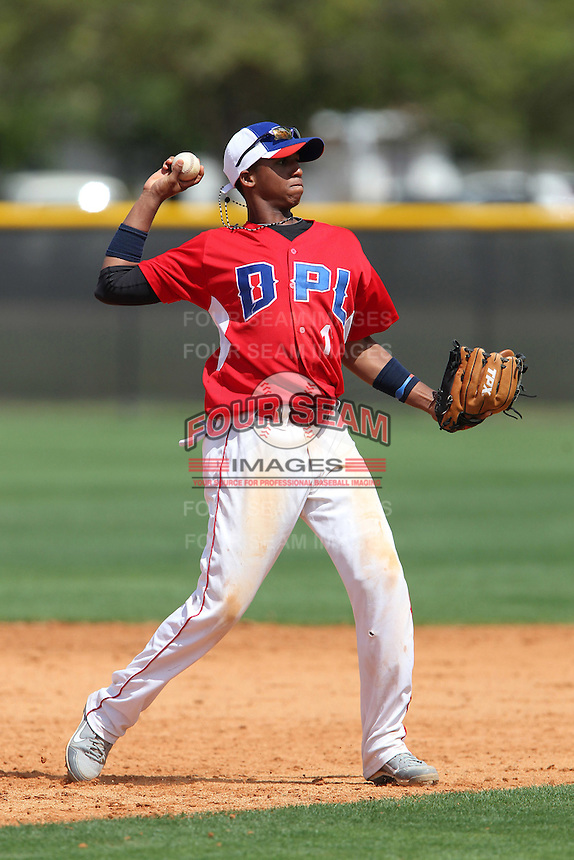 Dominican Elite Travel Team infielder Richard Urena #1 throws to first warming up during an intrasquad game at the New York Yankees Minor League Complex on March 14, 2012 in Tampa, Florida.  (Mike Janes/Four Seam Images)