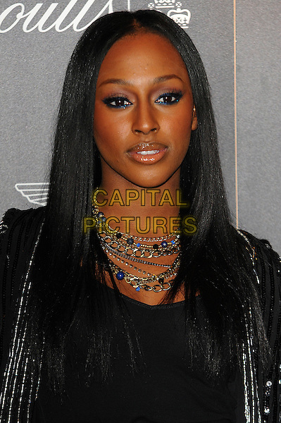 Alexandra Burke.Quintessentially Awards held at One Marylebone - Arrivals, London, England..28th September 2011.headshot portrait black necklaces gold chains blue eyeliner make-up beauty.CAP/CJ.©Chris Joseph/Capital Pictures.
