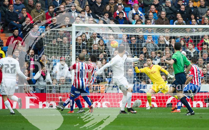 Real Madrid's Portuguese forward Cristiano Ronaldo scores