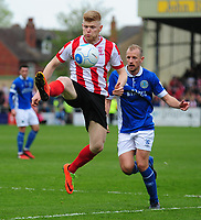 Lincoln City's Elliott Whitehouse brings the ball under control as he is closed down by Macclesfield Town's Luke Summerfield<br /> <br /> Photographer Andrew Vaughan/CameraSport<br /> <br /> Vanarama National League - Lincoln City v Macclesfield Town - Saturday 22nd April 2017 - Sincil Bank - Lincoln<br /> <br /> World Copyright &copy; 2017 CameraSport. All rights reserved. 43 Linden Ave. Countesthorpe. Leicester. England. LE8 5PG - Tel: +44 (0) 116 277 4147 - admin@camerasport.com - www.camerasport.com