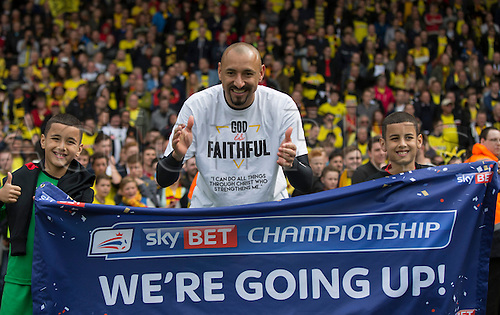 02.05.2015.  Watford, England. Skybet Championship. Watford versus Sheffield Wednesday. Watford's Heurelho Gomes with a flag saying we are going up.