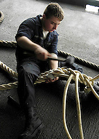 060106-N-7981E-046 Pacific Ocean (January 6, 2006) - Boatswain's Mate Seaman John Armstrong splices mooring line on the fantail of the USS Abraham Lincoln (CVN 72). USS Abraham Lincoln  is underway off the coast of Southern California for a Board of Inspection and Survey (INSURV) inspection and the final Fleet Response Plan (FRP) readiness training before a scheduled deployment later this spring. U.S. Navy photo by Photographer's Mate Airman Apprentice James Evans (RELEASED)
