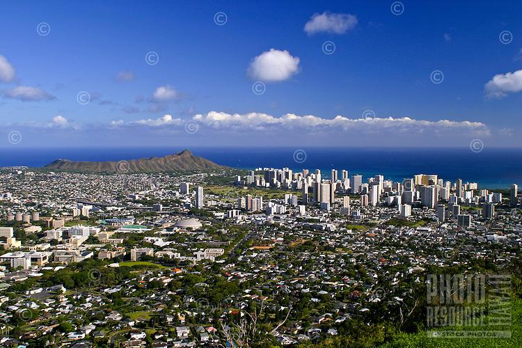 Many visitors to Oahu enjoy a panoramic view of Diamond Head, Waikiki, downtown Honolulu and southwest Oahu from Puu Ualakaa park and Wayside located off Tanatalus road above Manoa Valley, Oahu.