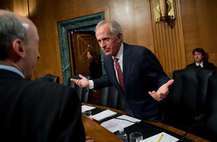 "UNITED STATES - MAY 22:  Sen. Bob Cokrer, R-Tenn., right, talks with Gary Gensler, chairman of the Commodity Futures Trading Commission, before a Senate Banking Committee hearing in Dirksen entitled ""Implementing Derivatives Reform: Reducing Systemic Risk and Improving Market Oversight."" (Photo By Tom Williams/CQ Roll Call)"