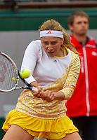 France, Paris, 26.05.2014. Tennis, Roland Garros, Ksenia Pervak (RUS) in action against Maris Sharapova (RUS)<br /> Photo:Tennisimages/Henk Koster