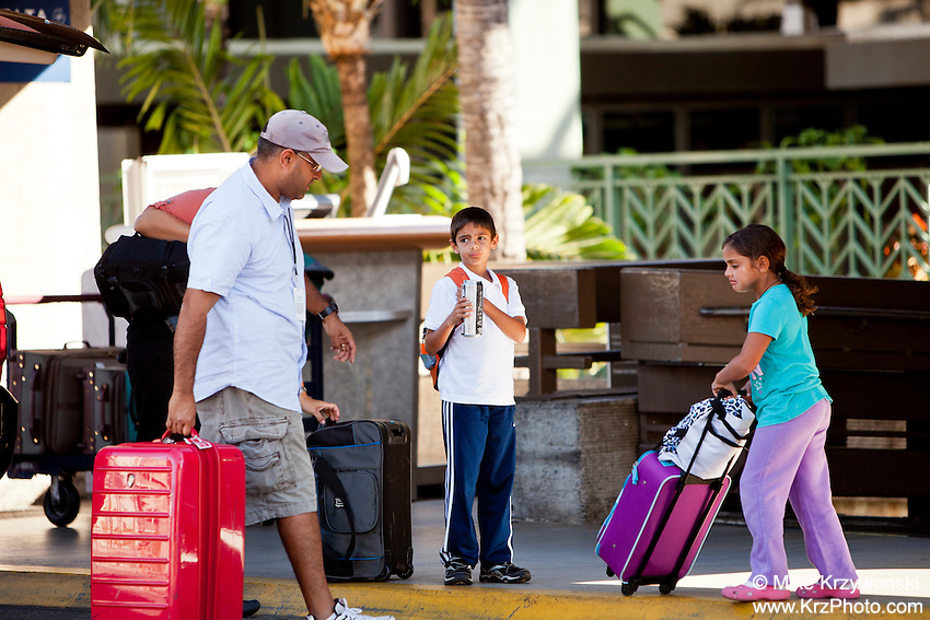 Middle Eastern Arabic family w/ luggage at the Honolulu International Airport, Oahu, Hawaii