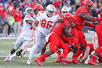 College Park, MD - November 12, 2016: Ohio State Buckeyes defensive lineman Dre'Mont Jones (86) tackles Maryland Terrapins running back Kenneth Goins Jr. (30)during game between Ohio St. and Maryland at  Capital One Field at Maryland Stadium in College Park, MD.  (Photo by Elliott Brown/Media Images International)