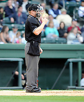 Umpire Travis Godec works a game between the Greenville Drive and West Virginia Power on Monday, April 15, 2013, at Fluor Field at the West End in Greenville, South Carolina. West Virginia won, 6-0. (Tom Priddy/Four Seam Images)