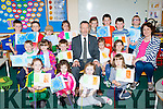 Sean Kelly MEP with the junior and Senior infants at Kilgarvan NS when he visited on Friday to unvail their European Union flag front row l-r: Breda Breen, katelyn O'donoghue, Ciara O'Riordan, Emma Quill, middle row: Colm Kelliher, Sophia Kelliher, Ollie Hayes, Sean Kelly, Ugne Raila, Aisling McCarthy. back row: Sean Foley, Seamus O'Donoghue, Caoilain desmond, Ella Healy, Erin O'Neill, Kieran O'Sullivan, Ciarn Foley, Declan Kelliher and Maria Casey teacher