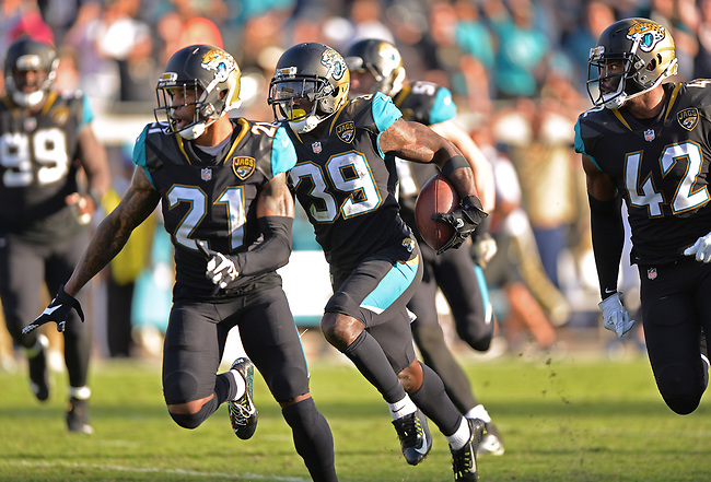 Jacksonville Jaguars safety Tashaun Gipson (39) receives an escort from teammates as he returns a fumble late in the fourth quarter against the Los Angeles Chargers in a NFL game Sunday, November 12, 2017 in Jacksonville, Fl.  (Rick Wilson/Jacksonville Jaguars)