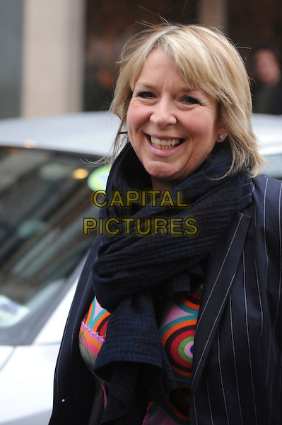 FERN BRITTON.Spotted near The Ivy, London, England..February 18th, 2010.**EXCLUSIVE**.half length blue pinstripe jacket black scarf .CAP/IA.©Ian Allis/Capital Pictures.
