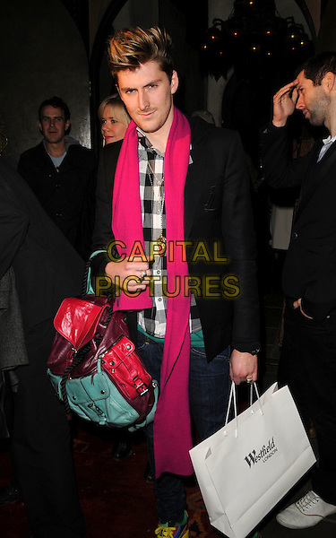 HENRY HOLLAND.The Westfield Fashion Forward Party Momo bar & restaurant, London, England..January 31st, 2008.full length black jacket pink scarf goody bag purse .CAP/CAN.©Can Nguyen/Capital Pictures