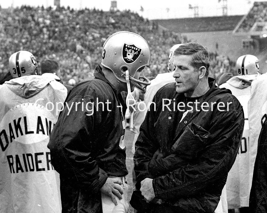 Raider quarterbacks Daryle Lamonica talking to George Blanda on side line..(1970 photo/Ron Riesterer)