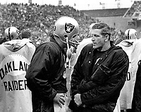 Raider quarterbacks Daryle Lamonica talking to George Blanda on side line..(1970 photo/Ron Riesterer)