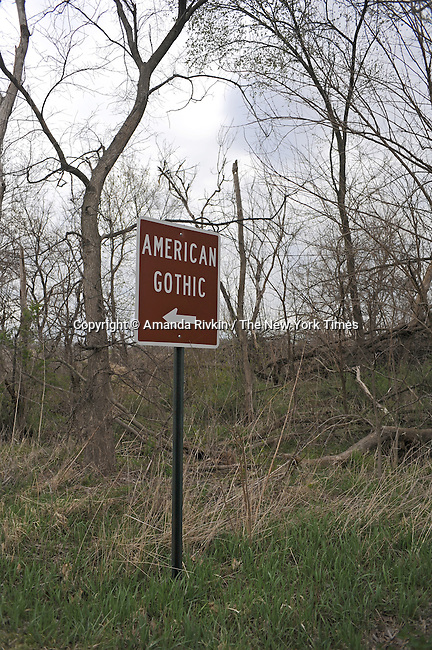 A sign leads the way to the American Gothic house, located about one and a half hour southwest of Iowa City in Eldon, Iowa on April 23, 2009.