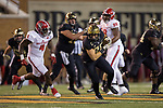 Cam Serigne (85) of the Wake Forest Demon Deacons turns up field after catching a pass during first half action against the North Carolina State Wolfpack at BB&T Field on November 18, 2017 in Winston-Salem, North Carolina.  (Brian Westerholt/Sports On Film)