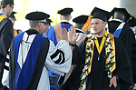 Regent Jason Geddes, left, high-fives with graduate Garrett Altus during the Western Nevada College 2017 Commencement in Carson City, Nev. on Monday, May 22, 2017.  <br />
