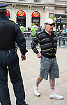 © Joel Goodman - 07973 332324 - all rights reserved . 13/09/2009 . London , UK . A man with a Blood and Honour tattoo on his leg at a March for England rally at Piccadilly Circus in Central London . Photo credit : Joel Goodman