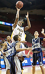The Gazette Bethesda-Chevy Chase High School's Austin Cooley skies over Largo High School's Donald Moses for a jump shot during their 3A state semi-final game at Comcast Center on Thursday evening. Largo won 73-64.