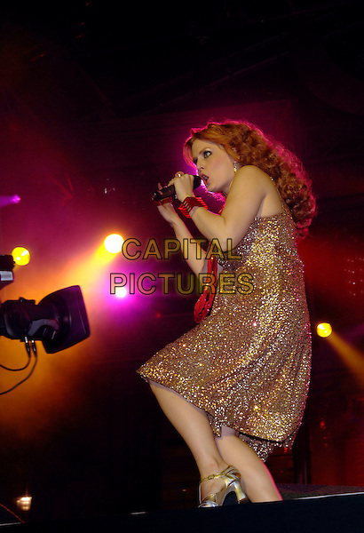 SCISSOR SISTERS - ANA MATRONIC.performing live on stage at the (Moto) Red Square free concert sponsored by Motorola, in Trafalgar Square,.London, England, 16th September 2006..full length band music gig gold sparkly dress red necklace jewellery funny dancing.Ref: PL.www.capitalpictures.com.sales@capitalpictures.com.©Phil Loftus/Capital Pictures