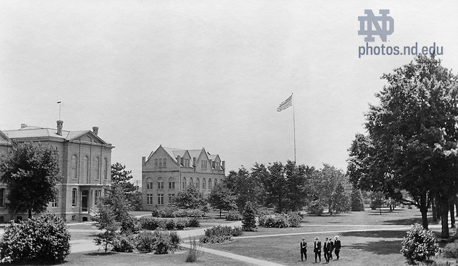 GTJS 3/27:  Veiw of Main Quad with Science Hall (LaFortune Hall), the Institute of Technology (Crowley Hall), and students, c1912..Image from the University of Notre Dame Archives.
