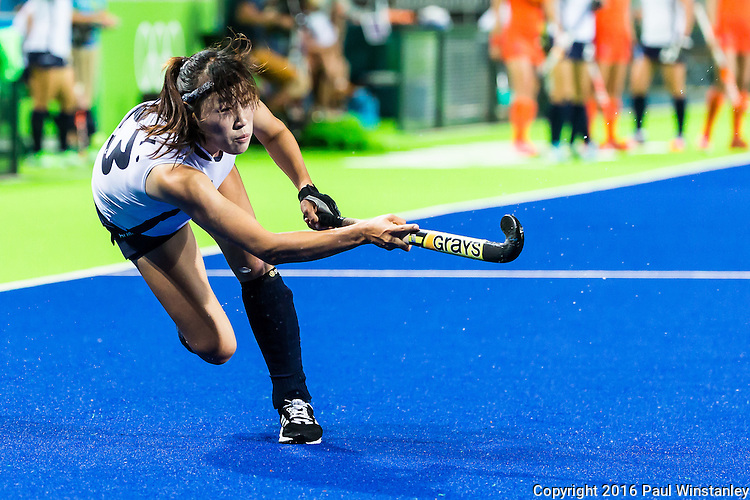 Youngsil Lee #23 of Korea completes her follow through during Netherlands vs Korea in a Pool A game at the Rio 2016 Olympics at the Olympic Hockey Centre in Rio de Janeiro, Brazil.
