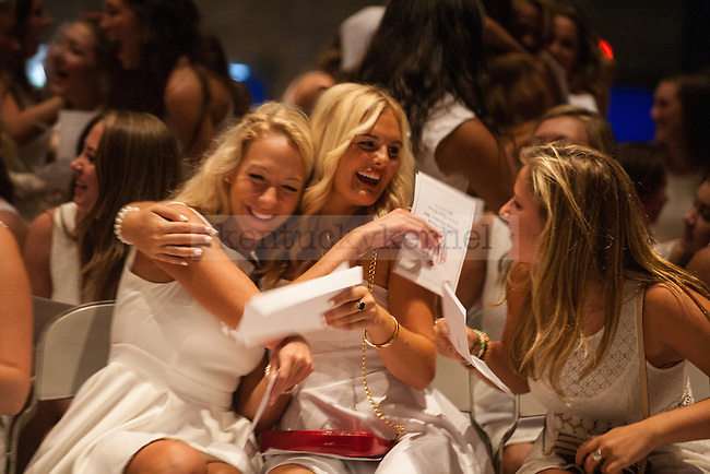 Sorority women receive their bids during UK's sorority bid day in Lexington, Ky., on Friday, August 22, 2014. Photo by Adam Pennavaria | Staff