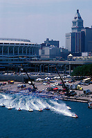 Start: Boats race away from the dock beneath the skyline and Riverfront Stadium. USFORA Formula One (F1) Tunnel Boats, Cincinnati, Ohio 1988