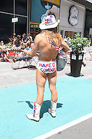 NEW YORK, NY - JUNE 21: The Naked Cowboy in the green zone on the first day of NYPD (New York Police Department) enforcement of the new pedestrian zones in Times Square where costumed characters and those selling bus or show tickets are required to solicit only in the designated green zone in New York, New York on June 21, 2016.  Photo Credit: Rainmaker Photo/MediaPunch