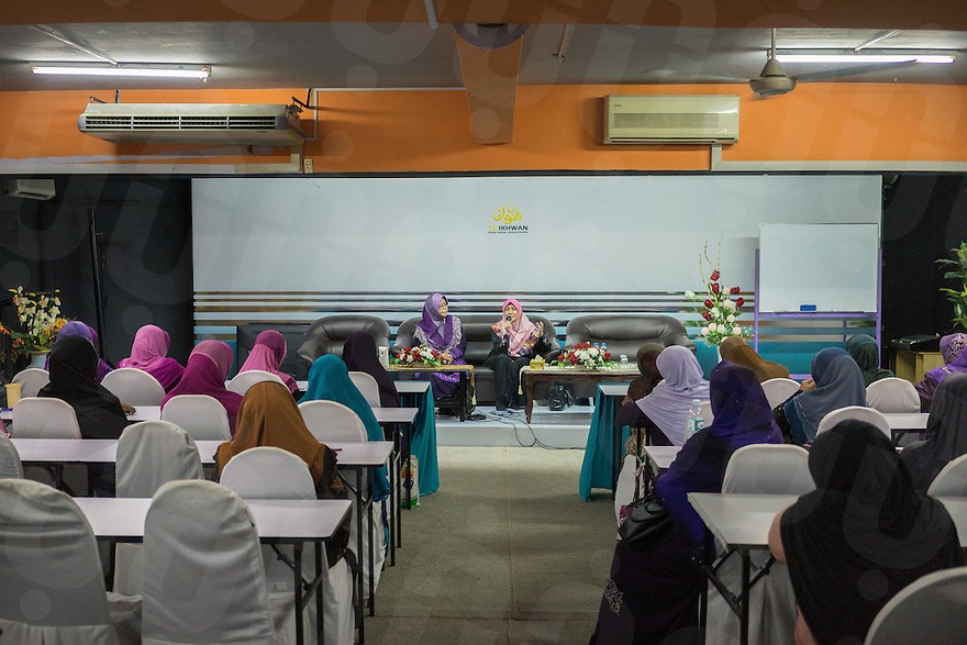 January 10, 2015 - Rawang (Malaysia). Dr. Azlina Jamaluddin (right) offers a seminary on jealousy in polygamy to a group of Global Ikhwan female members. Dentist at the company's Clinic in Rawang, she was one of the Obedient Wives Club Organiser. Educated in Australia she joined the company in 2001. © Thomas Cristofoletti / Ruom