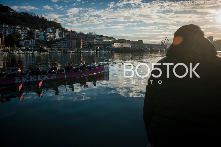 Female rowers on San Juan rower Club on a workout session in the bay. Pasaia (Basque Country). January 28, 2017. (Gari Garaialde / BostokPhoto)