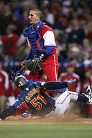 Ariel Pestano of the Cuban national team can only watch as Ichiro Suzuki of Japan scores during the World Baseball Championships at Petco Park in San Diego,California on March 20, 2006. Photo by Larry Goren/Four Seam Images
