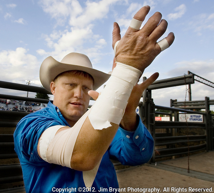 Heath Ford, World Champion Bareback Rider,  from Slocum, TX tapes up his arm before the bare back riding event at the Kitsap County Fair and Stampede held Aug. 22 to Aug. 26, 2012 in Silverdale, WA. ©2012. Jim Bryant Photo. All Rights Reserved