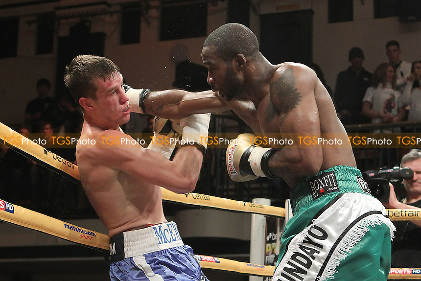 Larry Ekundayo (green shorts) defeats Craig McEwan in a Prizefighter The Light-Middleweights III boxing contest at York Hall, Bethnal Green, London, promoted by Matchroom Sports - 03/11/12 - MANDATORY CREDIT: Gavin Ellis/TGSPHOTO - Self billing applies where appropriate - 0845 094 6026 - contact@tgsphoto.co.uk - NO UNPAID USE.