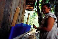 Flower Hmong hilltribe woman working spun blue fibers, Chiang Mai, Thailand