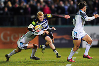 Tom Homer of Bath Rugby takes on the Newcastle Falcons defence. Aviva Premiership match, between Bath Rugby and Newcastle Falcons on March 18, 2016 at the Recreation Ground in Bath, England. Photo by: Patrick Khachfe / Onside Images