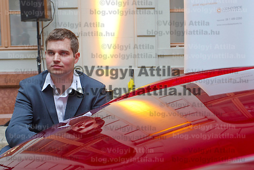 Press conference presenting the manually assembled Farralli & Mazzanti Vulca S luxury sports car to be produced in a limited series of ten pieces designed by Hungarian designer Zsolt Tarnok (left). Budapest, Hungary. Tuesday, 22. June 2010. ATTILA VOLGYI